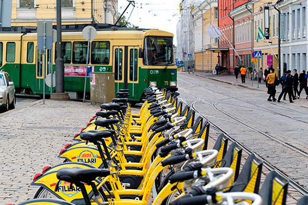 City bikes on the front and tram behind. Photo Miska Engström.